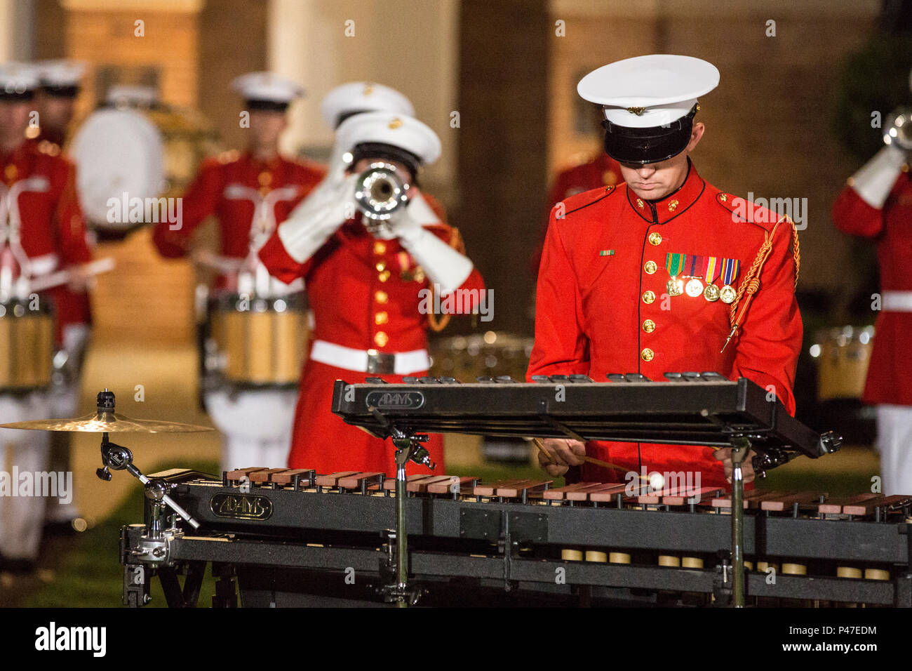U.S. Marines with the Drum and Bugle Corps perform during the evening parade at Marine Barracks Washington, Washington, D.C., June 24, 2016. Evening parades are held as a means of honoring senior officials, distinguished citizens and supporters of the Marine Corps. (U.S. Marine Corps photo by Pfc. Alex A. Quiles) Stock Photo