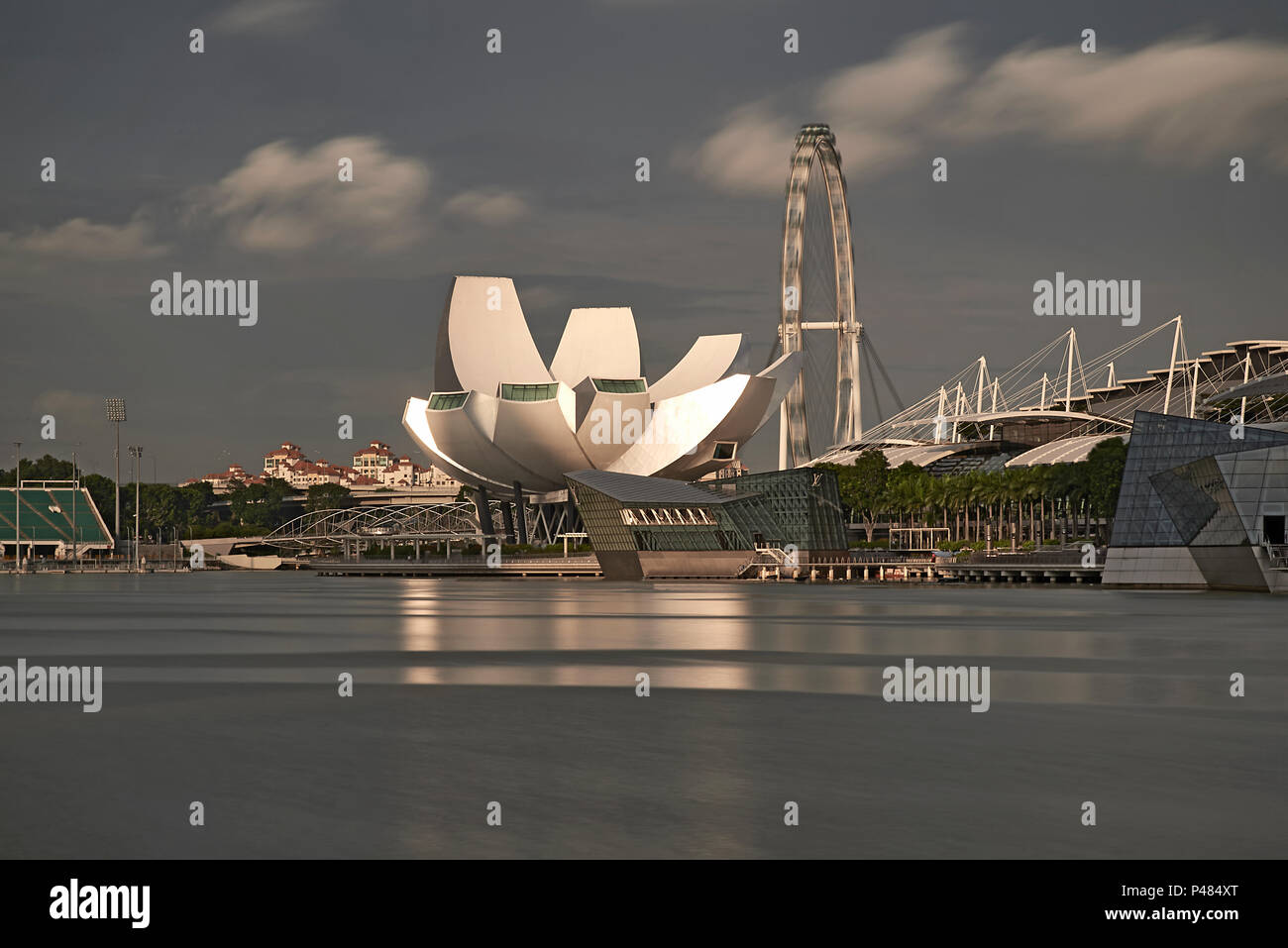 Landscape of the MArina Bay area of Singapore with the famous Marina Bay Sands building and the modern architecture of the Science Museum - Stock Image