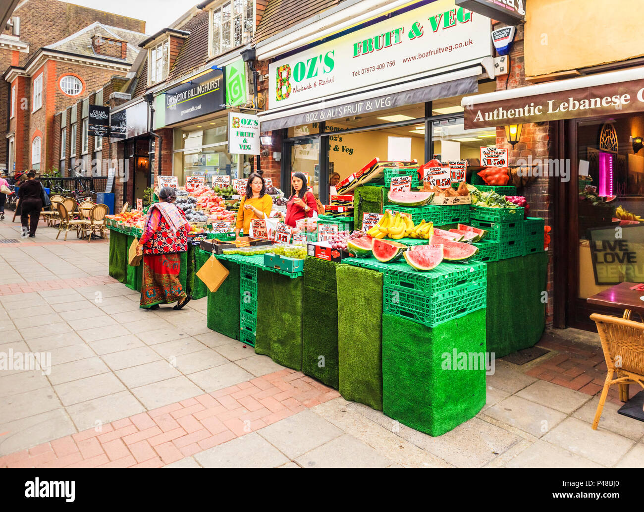 Fruit and vegetables display outside Boz's, a traditional greengrocer's shop in Church Path, Woking, a town in Surrey, southeast England, UK - Stock Image