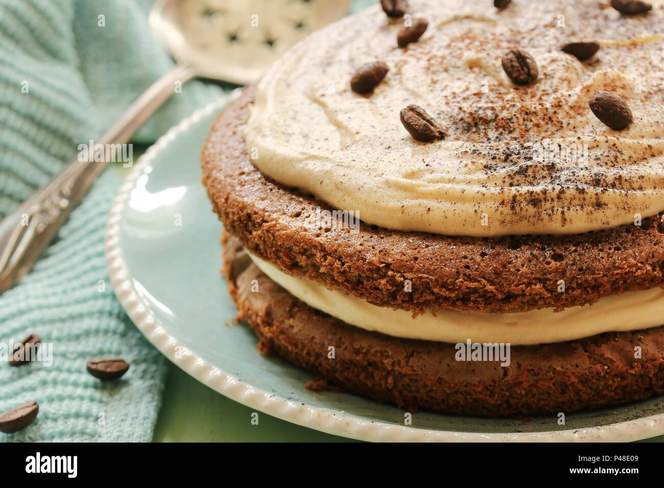 Homemade Coffee Expresso cake with white chocolate mocha frosting, close up selective focus