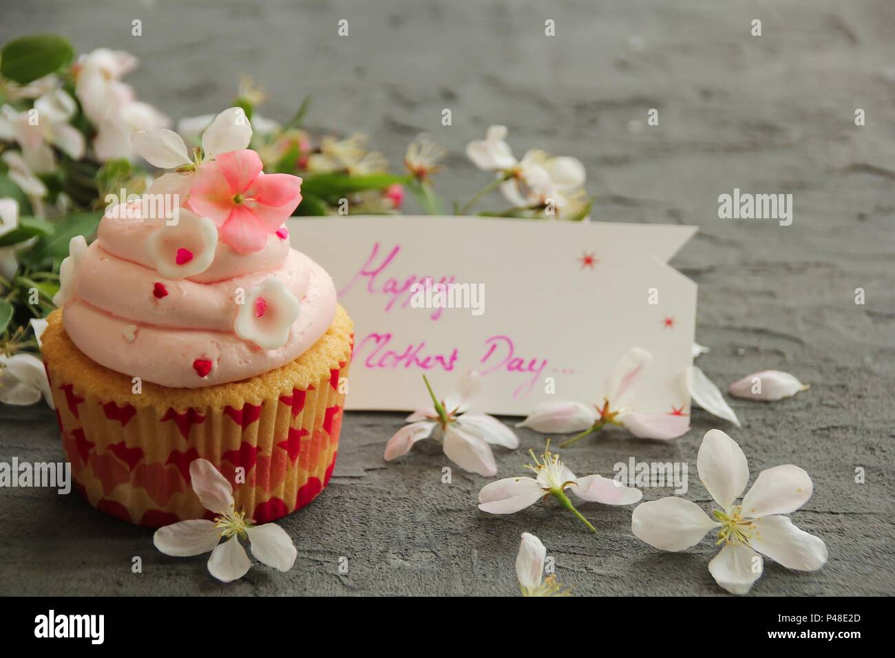 Homemade Cupcake With Frosting And Fondant Flowers Stock Photo