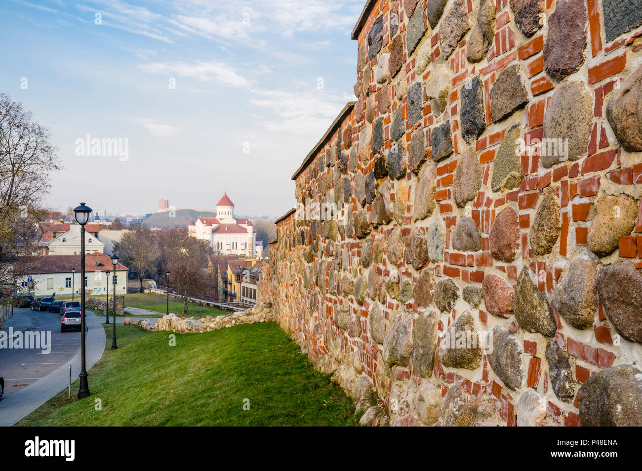 Old wall of Vilnius Old Town and Church of the Holy Mother of God in background. Vilnius, Lithuania, Europe - Stock Image