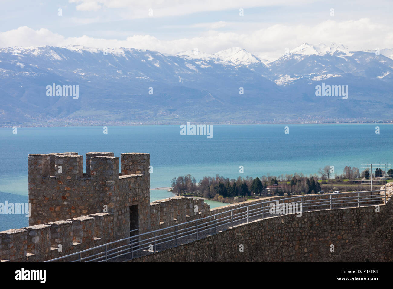 Ohrid, Republic of Macedonia : Landscape with snowcapped mountains and Ohrid lake with Samuel's Fortress in foreground. Built on the site of an earlie - Stock Image