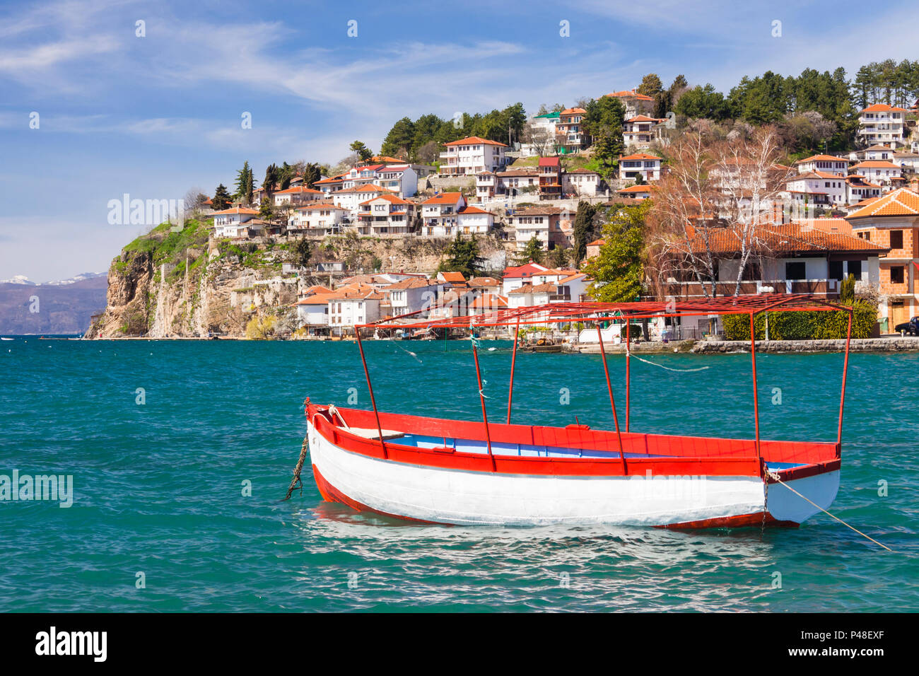 Ohrid, Republic of Macedonia : Boat moored on the Ohrid Lake with general view of the Unesco listed old town in background. Stock Photo