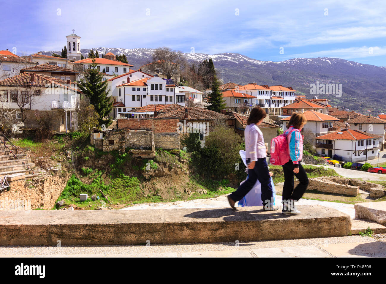 Ohrid, Republic of Macedonia : Children walk past an overview of the old town of Ohrid. - Stock Image