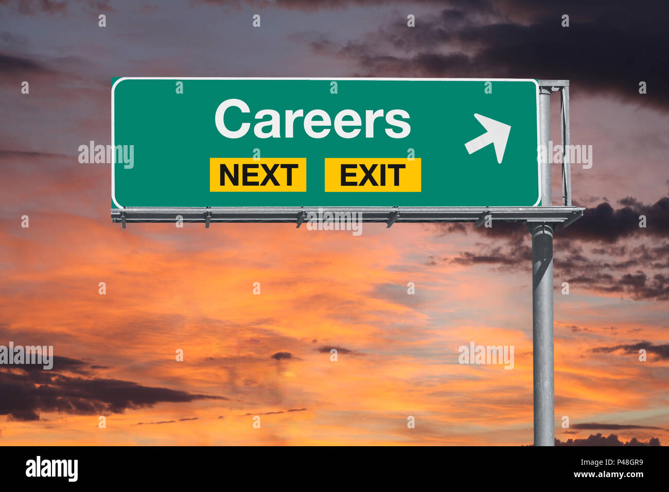 Careers next exit freeway sign with sunset sky. - Stock Image