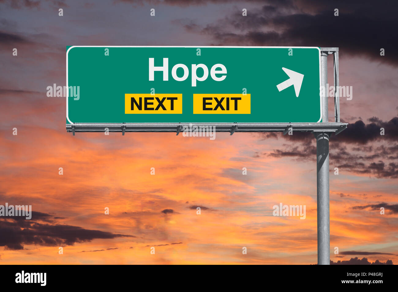 Hope next exit freeway sign with sunset sky. - Stock Image