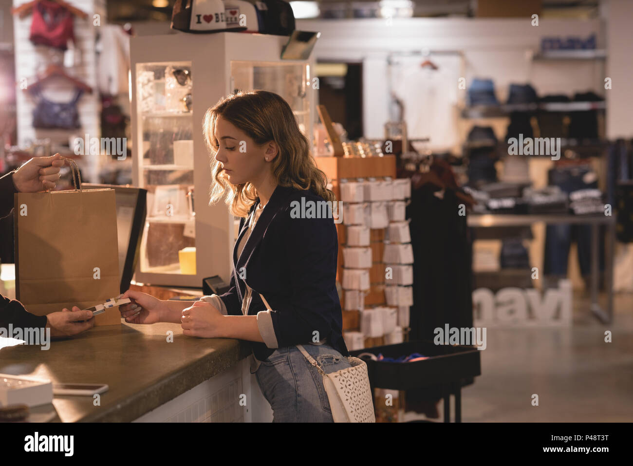 Woman making payment through card - Stock Image
