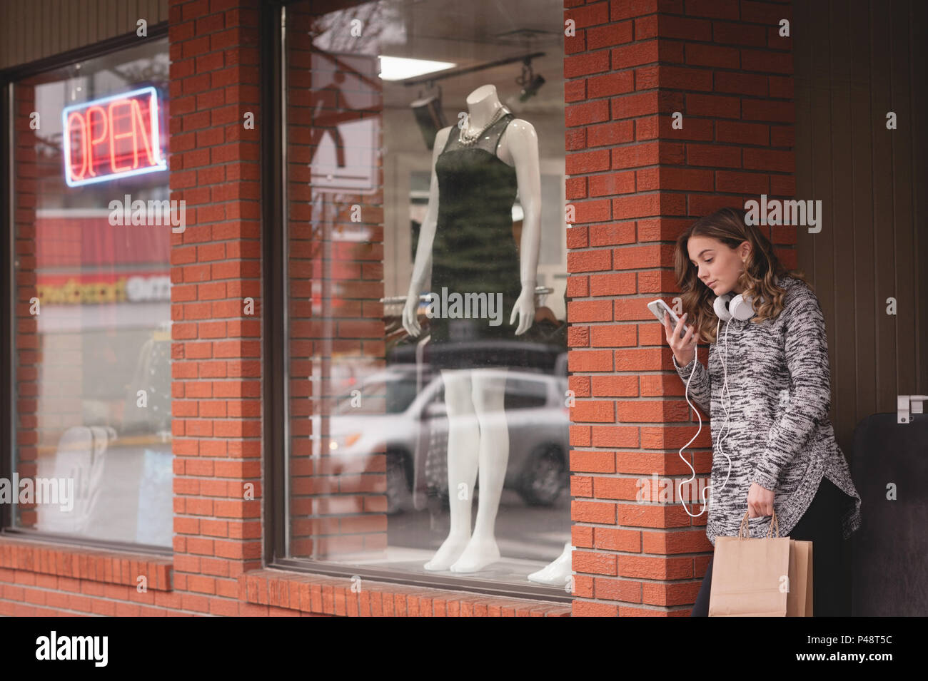 Beautiful woman using mobile phone - Stock Image
