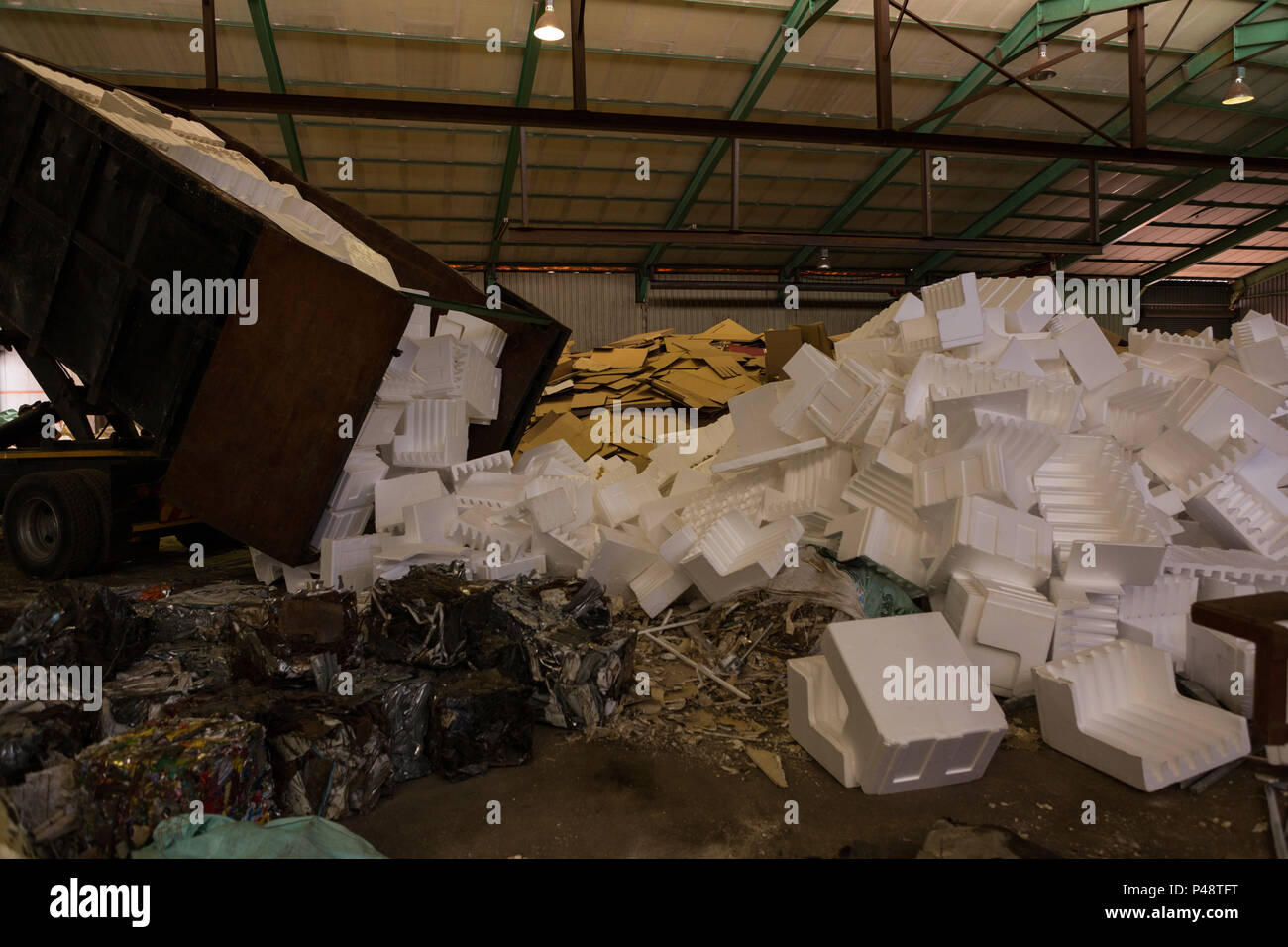 Truck emptying thermocol in the scrapyard Stock Photo: 209177916 - Alamy