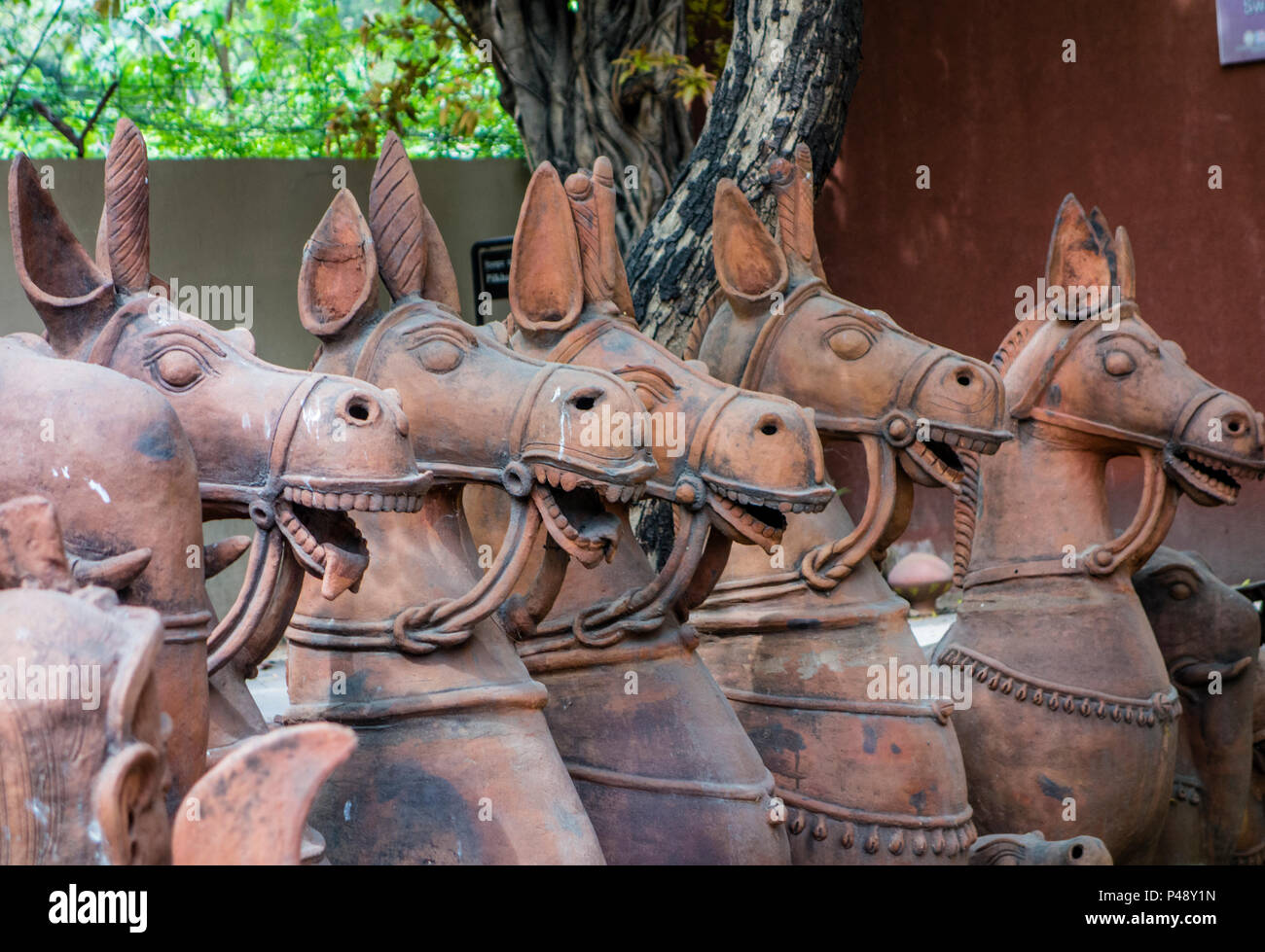 Exhibit of stone carvings of horses typical of Rajasthan in the National Crafts Museum, New Delhi, India Stock Photo