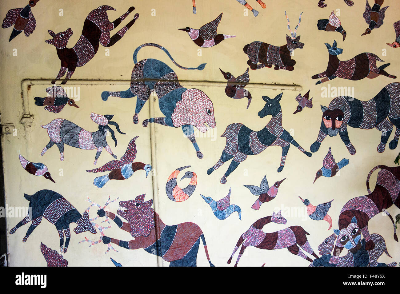 Exhibit of a wall painting with colorful animals in the National Crafts Museum, New Delhi, India - Stock Image