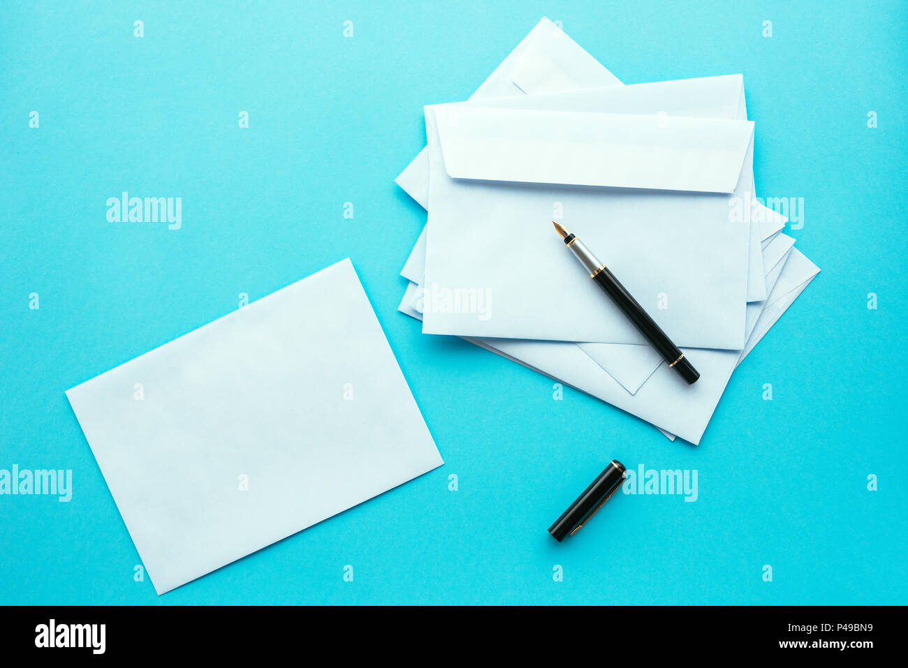 Blank white envelopes as mock up copy space for communication and correspondence themes, top view - Stock Image
