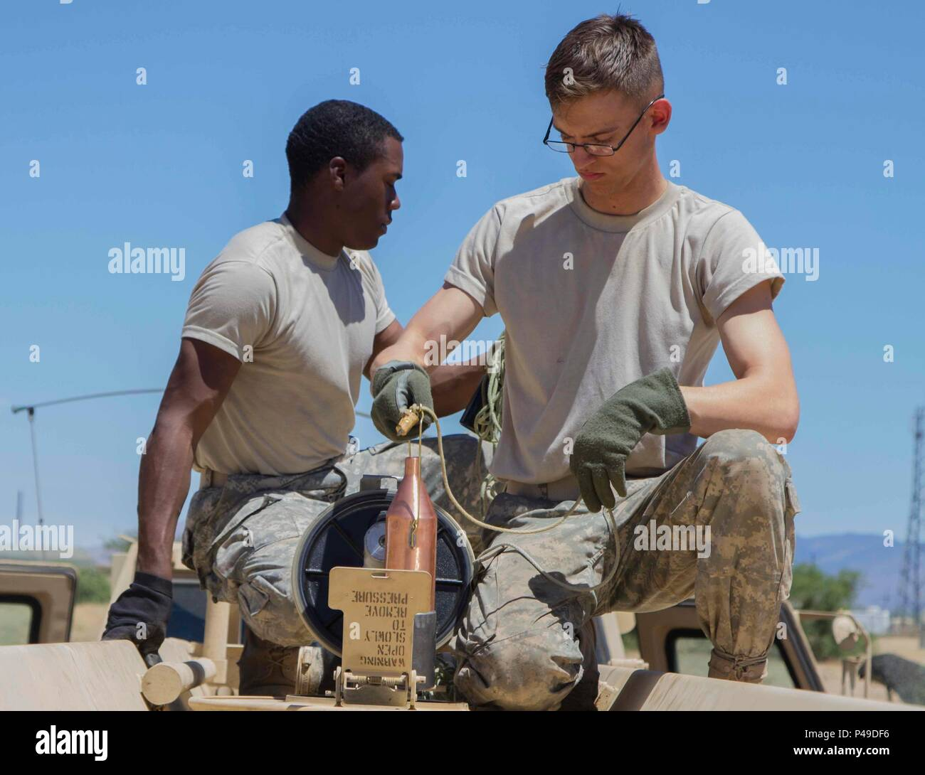 U.S. Army Reserve Pfc. Christian Jones and Spc. Mario Weatherby, Petroleum Supply Specialists,  383rd Quartermaster Company, Weldon Springs, Mo., take a fuel sample during the annual  Quartermaster Liquid Logistics Exercise, Fort Huachuca, Ariz., June 18, 2016. QLLEX is an annual  U.S. Army Reserve logistics training event that focuses on the technical training of Quartermaster  Soldiers for the storage, production and on-time distribution of water and petroleum in bulk amounts  equivalent to what they would work with in a combat environment. (Photo by U.S. Army Spc. James  Lefty Larimer, 367t Stock Photo
