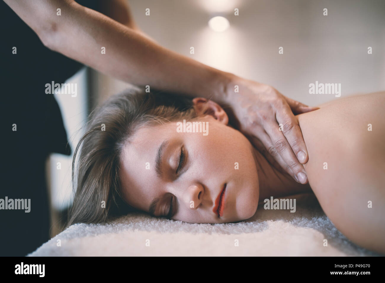 Rejuvenating relaxing massage by masseur - Stock Image