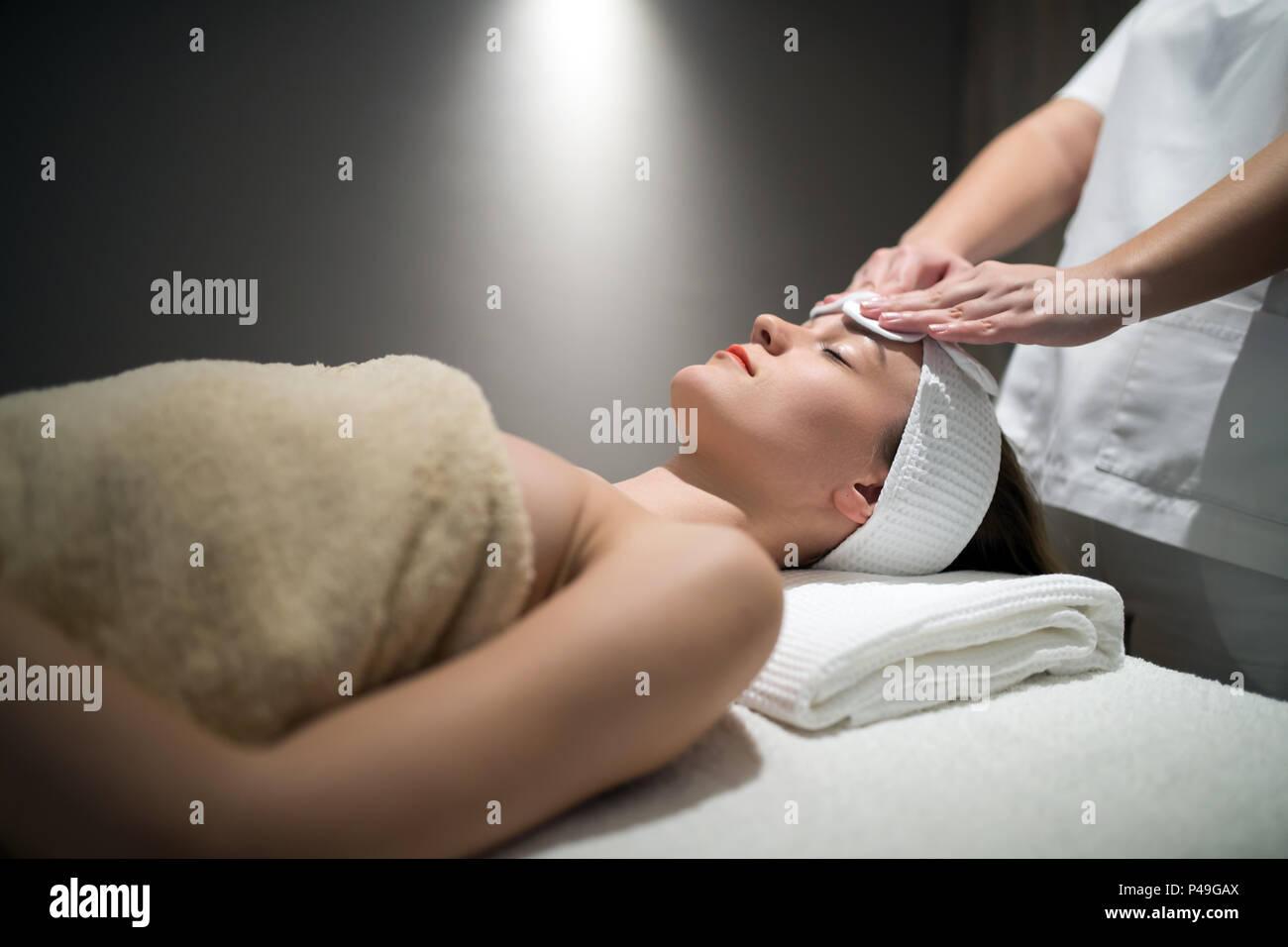 Relaxing anti stress facial massage - Stock Image
