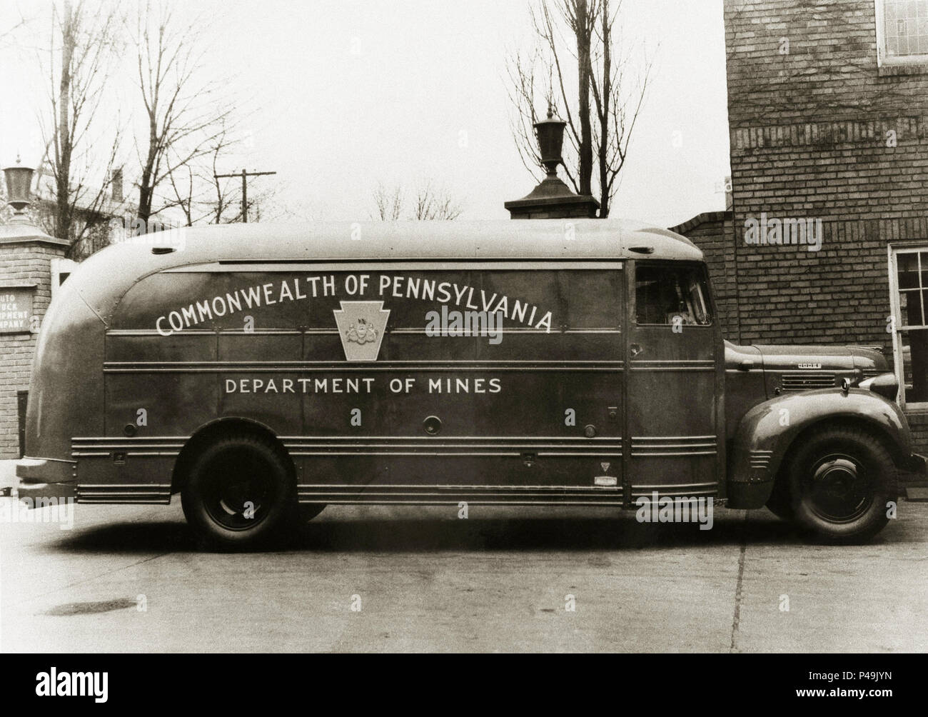 """The Commonwealth of Pennsylvania USA Mine Rescue Truck of 1947,equipped with the necessary breathing apparatus, gas masks, first-aid supplies, analytical apparatus and such other chemical and scientific instruments commonly used and necessary in the work of first aid and mine rescue. """"Pennsylvania Anthracite Coal Mine Act."""" Pennsylvania was the largest producer of Anthracite coal during the Industrial revolution in the United States. Particularly  around the Wilkes Barre and Scranton areas, Luzerne and Lackawanna counties of North Eastern Pennsylvania. Mine rescue was always in demand. Stock Photo"""
