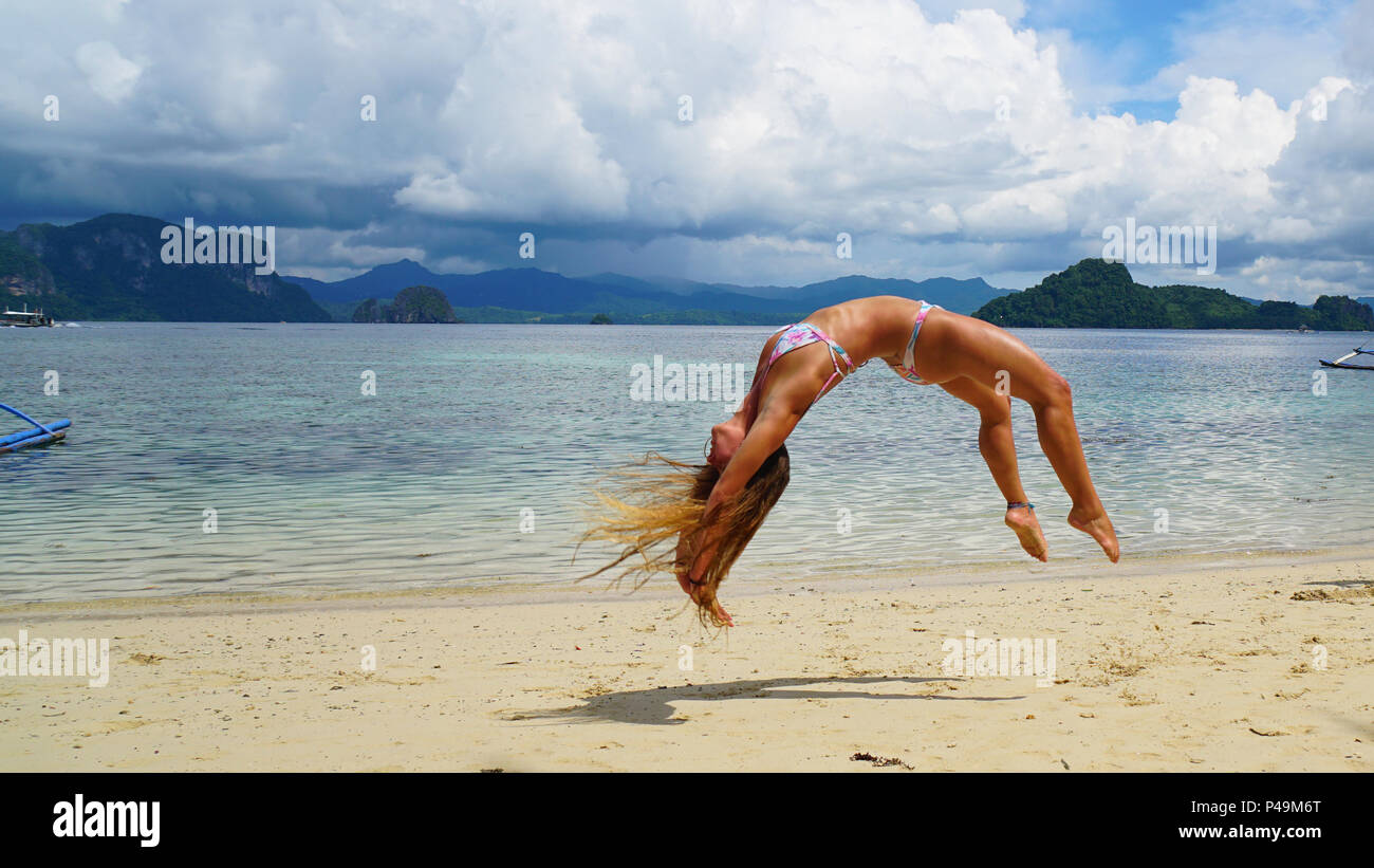 Back Flip on the Beach of Elnido Palawan - Stock Image
