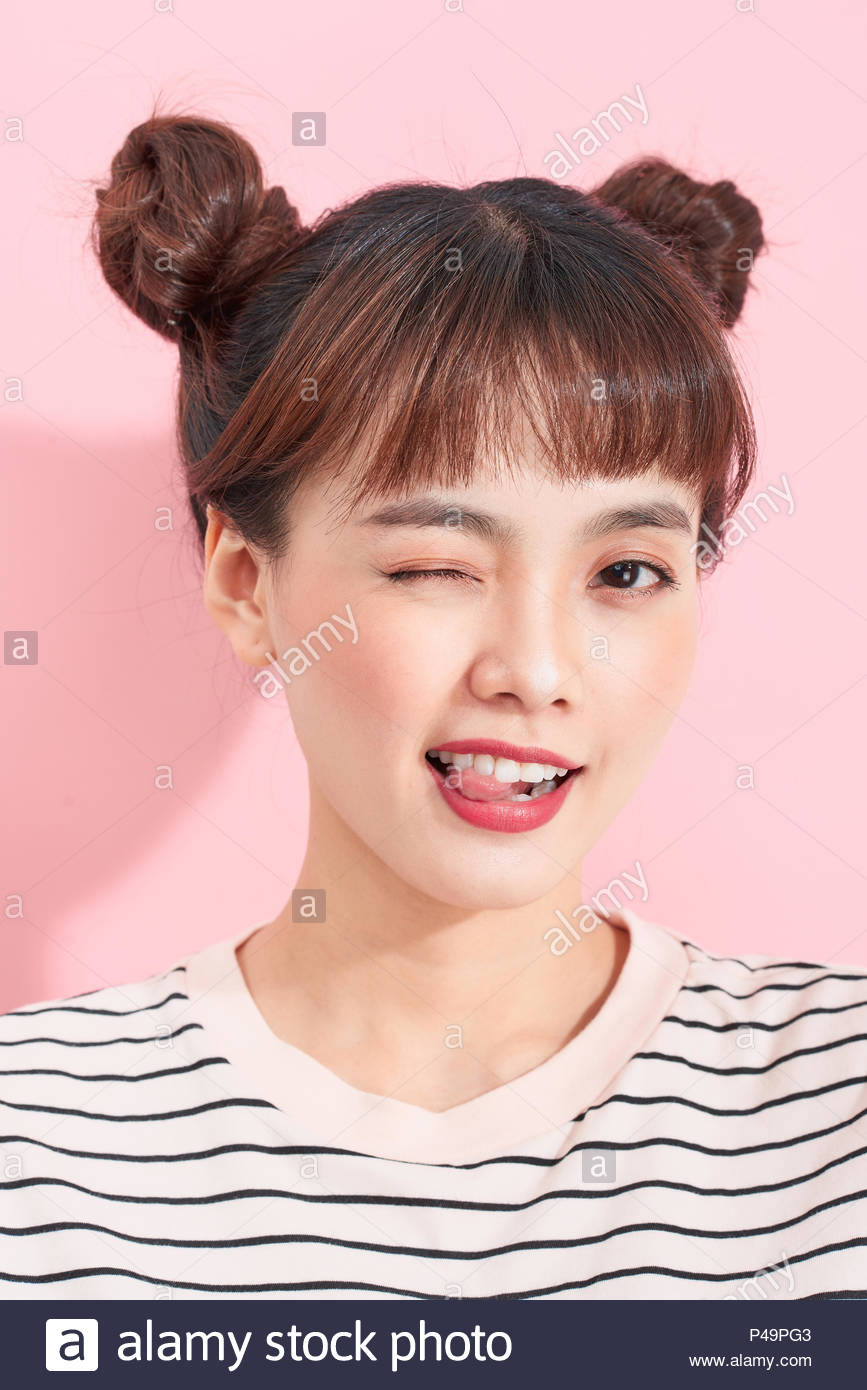 Portrait Of Cool Carefree Asian Woman With Bun Hairstyle Being