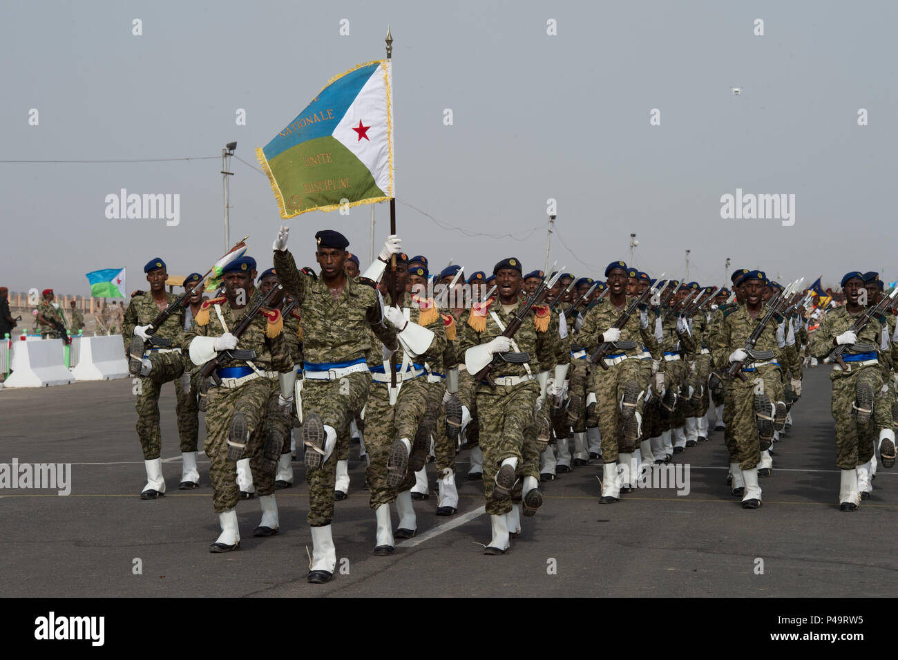 Members of the Djiboutian Armed Forces march in sync during the Djibouti Independence Day parade June 27. 2016, at Djibouti. Service members from all Djiboutian military branches participated in the parade along with law enforcement. (U.S. Air Force photo by Staff Sgt. Eric Summers Jr.) - Stock Image