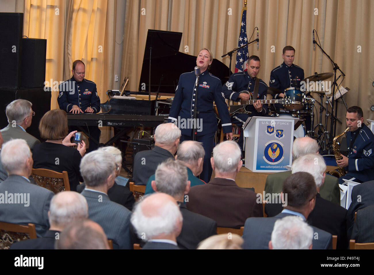 The U.S. Air Forces in Europe's Band Ambassadors Jazz Ensemble performs at the Friendship House June 20, 2016, in Minsk, Belarus. The band played a concert for WWII veterans, Afghanistan conflict veterans and Chernobyl liquidators. Scott Rauland, U.S. Chargé d'Affaires to Belarus, and Svetlana Alexievich, a Nobel Prize laureate, were also in attendance. The United States, Belarus, and other ally and partner nations continue to remember and honor shared World War II sacrifices. The USAFE Band's performances reflect shared memories and seek to encourage future partnerships. Stock Photo