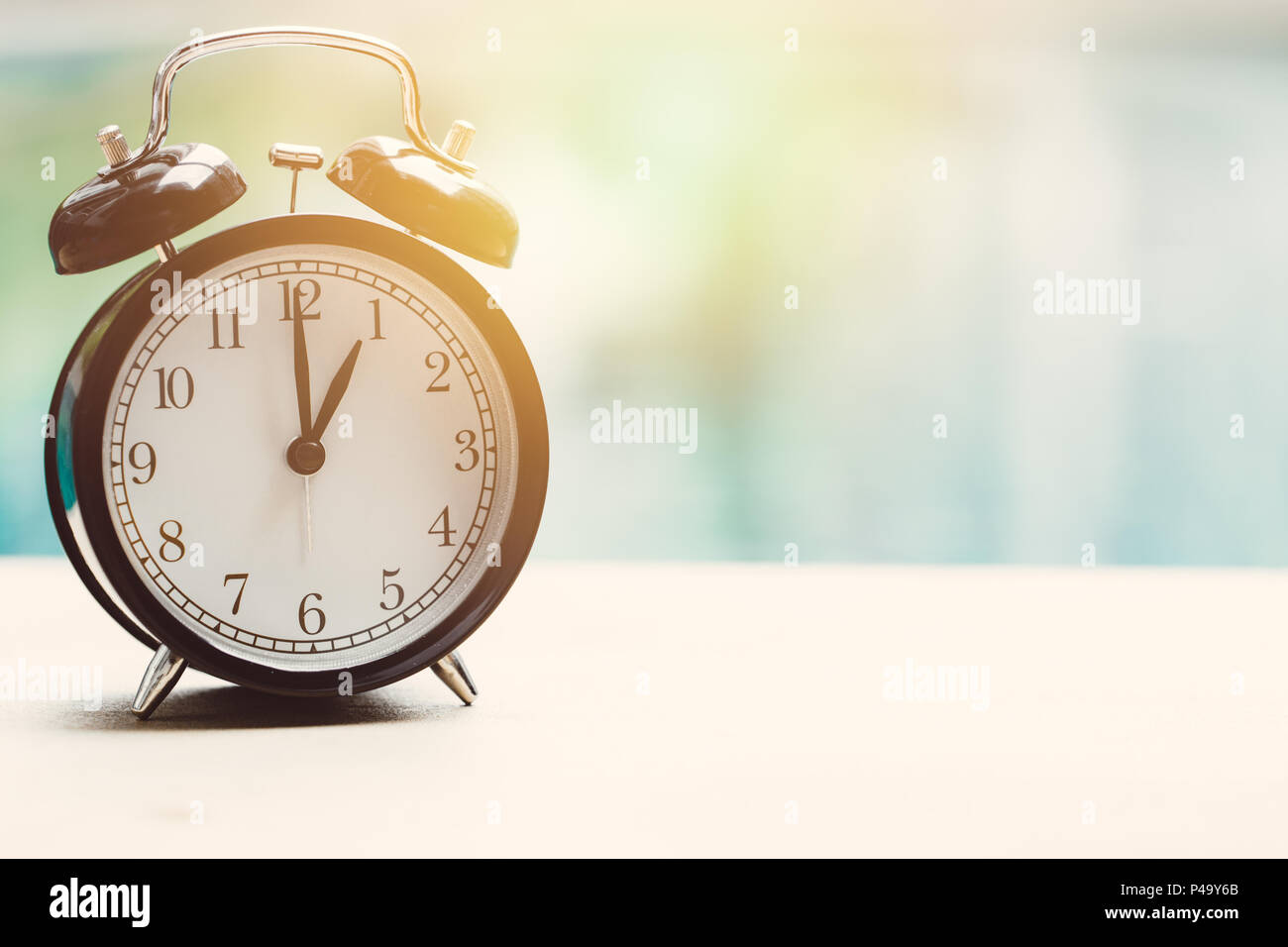 13 o'clock retro clock at the swimming pool outdoor relax time holiday time concept. - Stock Image