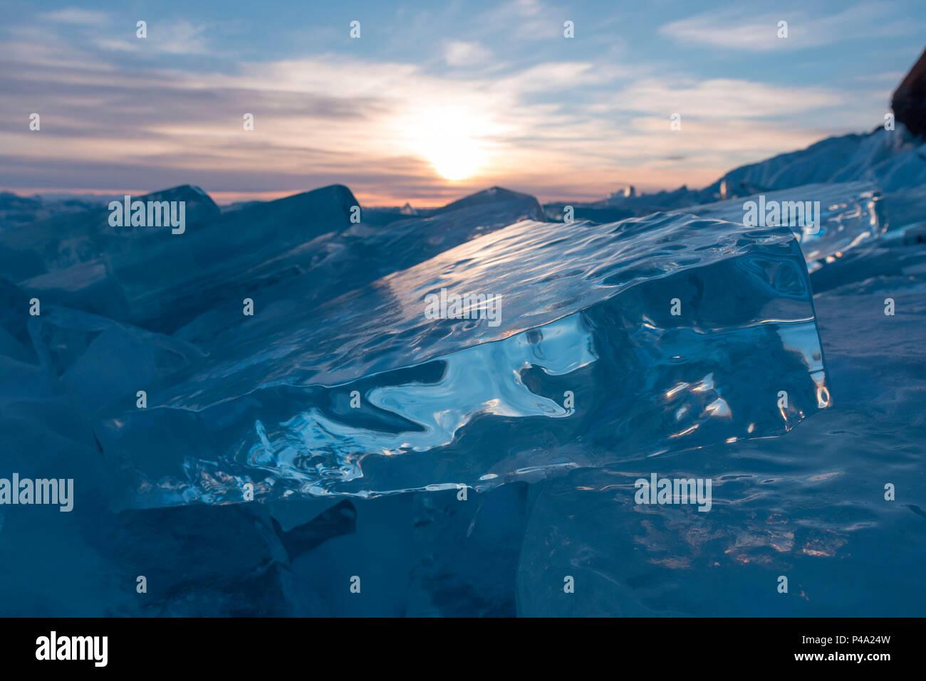 Sun reflections on ice at Lake Baikal, Irkutsk region, Siberia, Russia - Stock Image