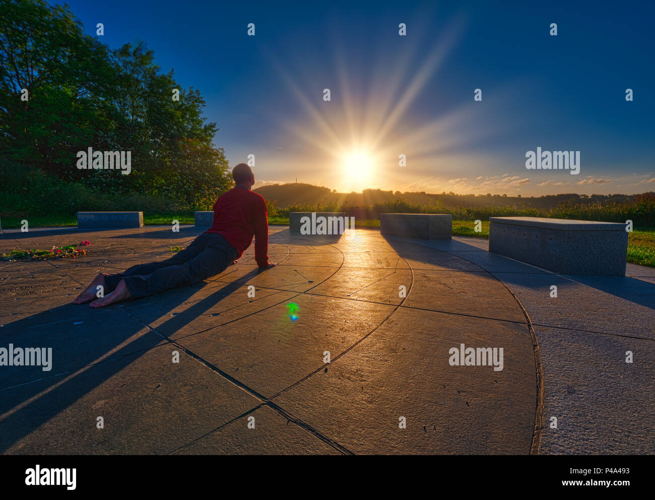 Wirksworth, Derbyshire, UK. 21st June, 2018. International World Yoga Day saluting the sun rising on the summer estival solstice at the star disc above Wirksworth in the Derbyshire Dales Credit: Doug Blane/Alamy Live News - Stock Image