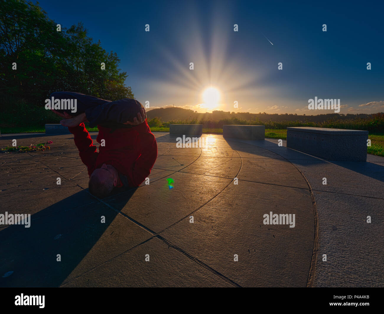 Wirksworth, Derbyshire, UK. 21st June, 2018. International World Yoga Day upside down lotus pose Urdhva Padmasana saluting the sun rising on the summer estival solstice at the star disc above Wirksworth in the Derbyshire Dales Credit: Doug Blane/Alamy Live News - Stock Image