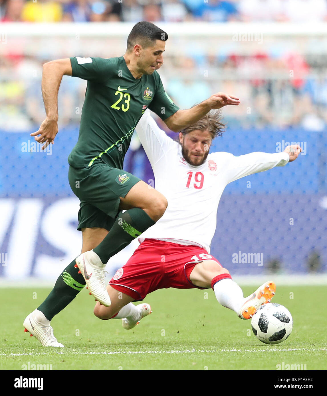 Samara, Russia. 21st June, 2018. Lasse Schone (R) of Denmark vies with Tom Rogic of Australia during the 2018 FIFA World Cup Group C match between Denmark and Australia in Samara, Russia, June 21, 2018. Credit: Ye Pingfan/Xinhua/Alamy Live News - Stock Image