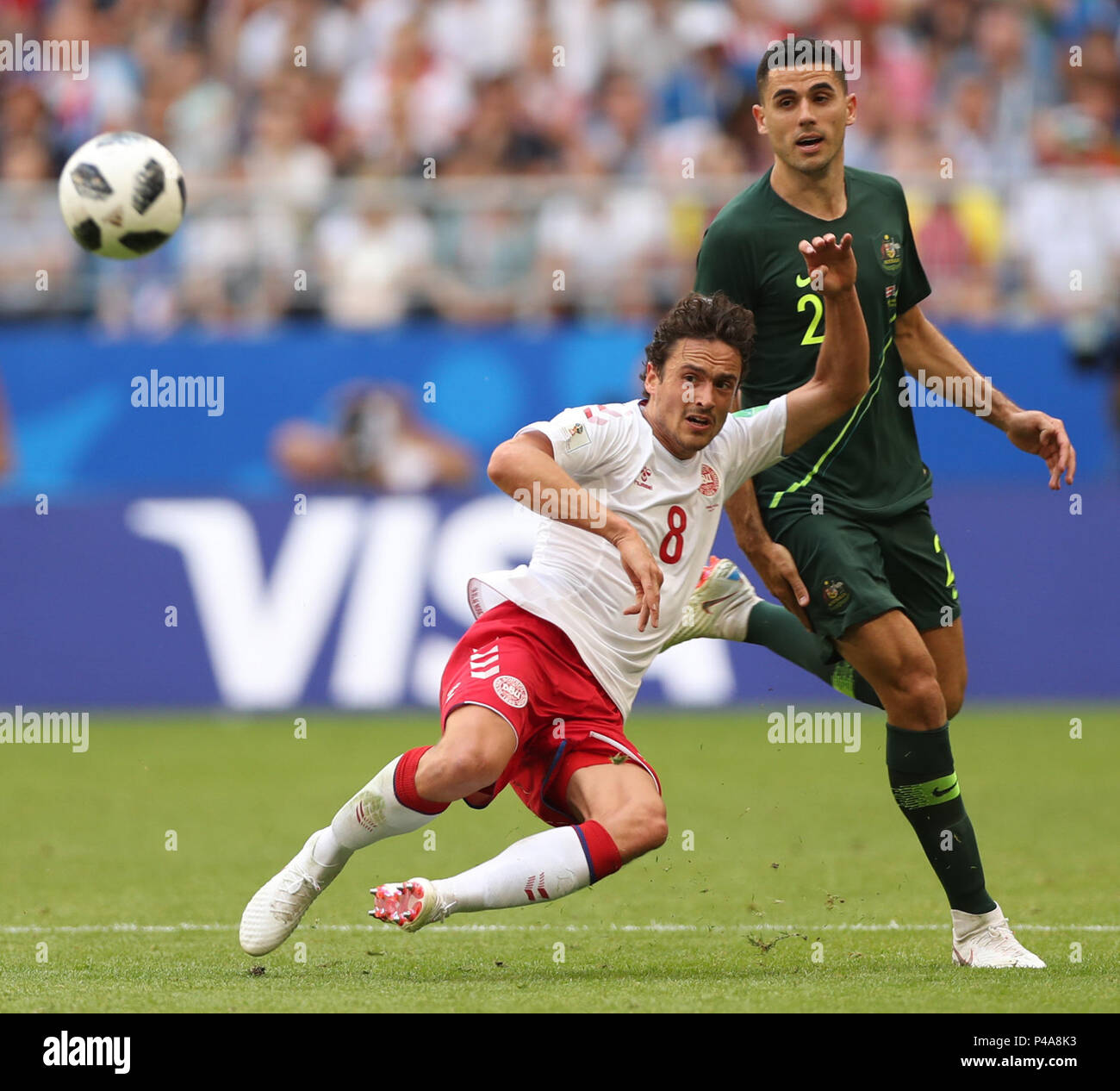 Samara, Russia. 21st June, 2018. Thomas Delaney (bottom) of Denmark vies with Tom Rogic of Australia during the 2018 FIFA World Cup Group C match between Denmark and Australia in Samara, Russia, June 21, 2018. Credit: Fei Maohua/Xinhua/Alamy Live News - Stock Image