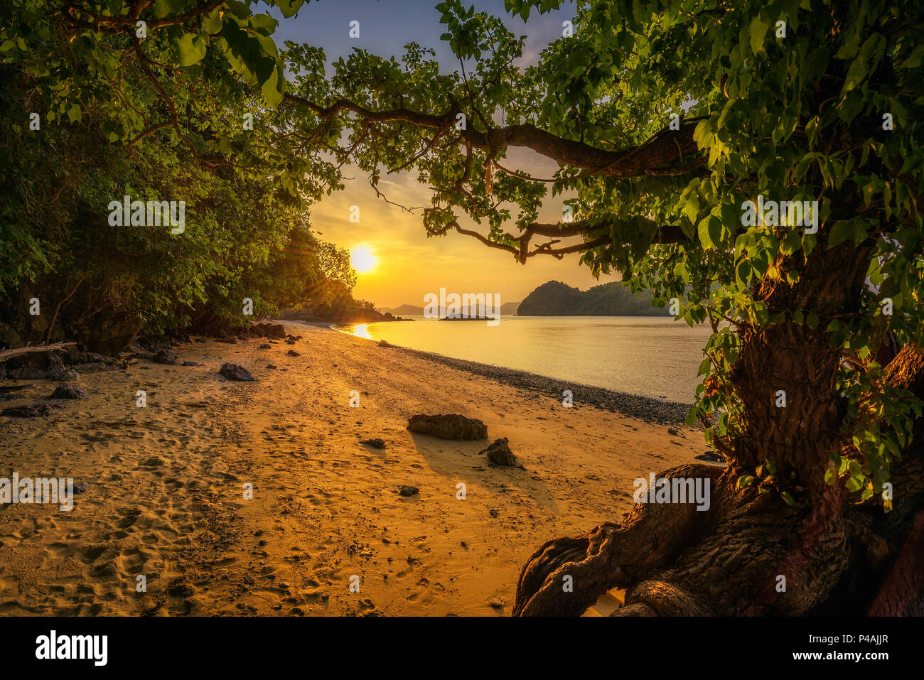 Sunset over the beach of Ko Hong island in the Krabi province, Thailand - Stock Image