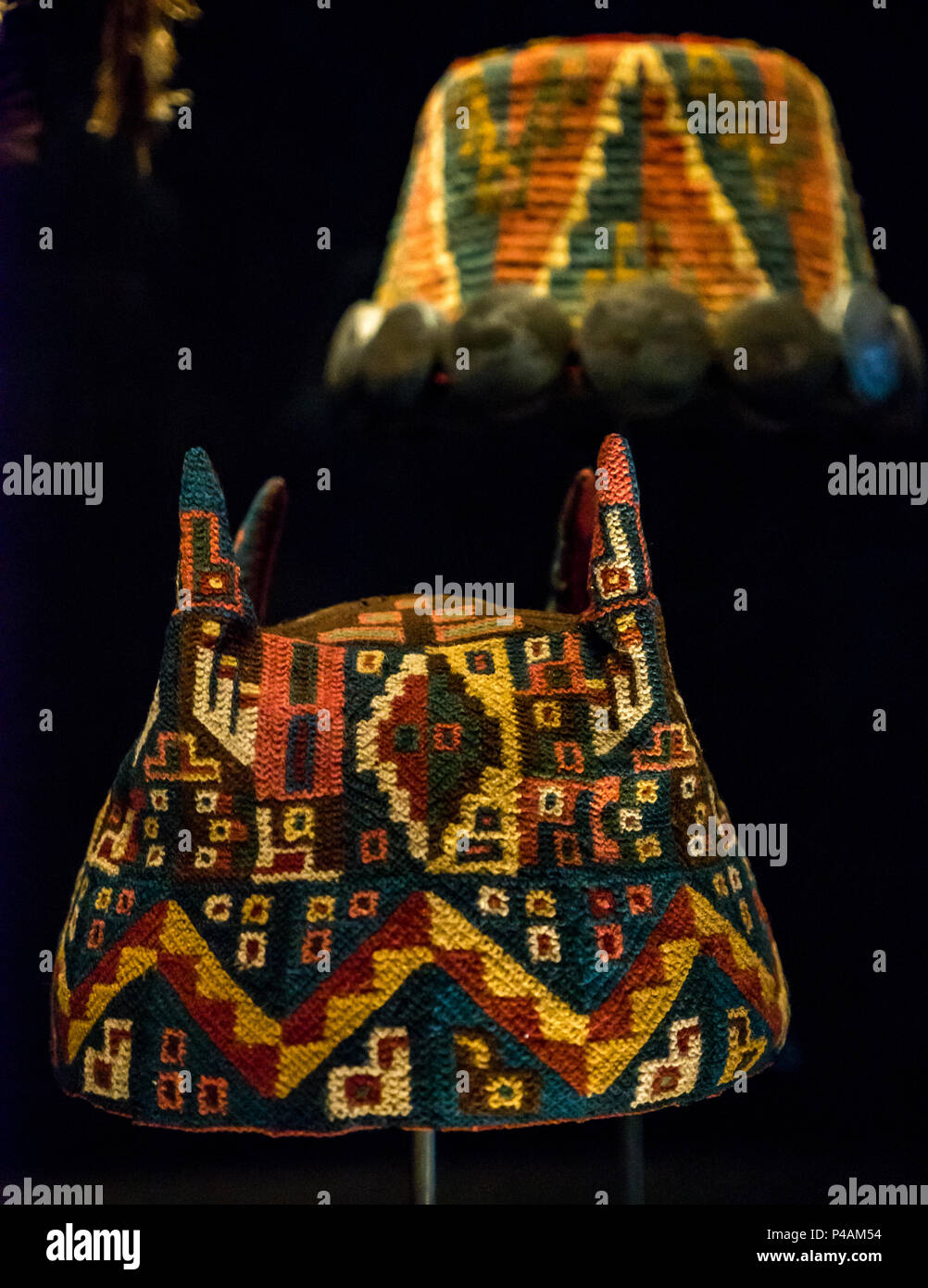 Colourful truncated conical wool hats worn by Altiplano tribes, museum display, Chilean Museum of Pre-Colombian Art, Santiago, Chile, South America - Stock Image
