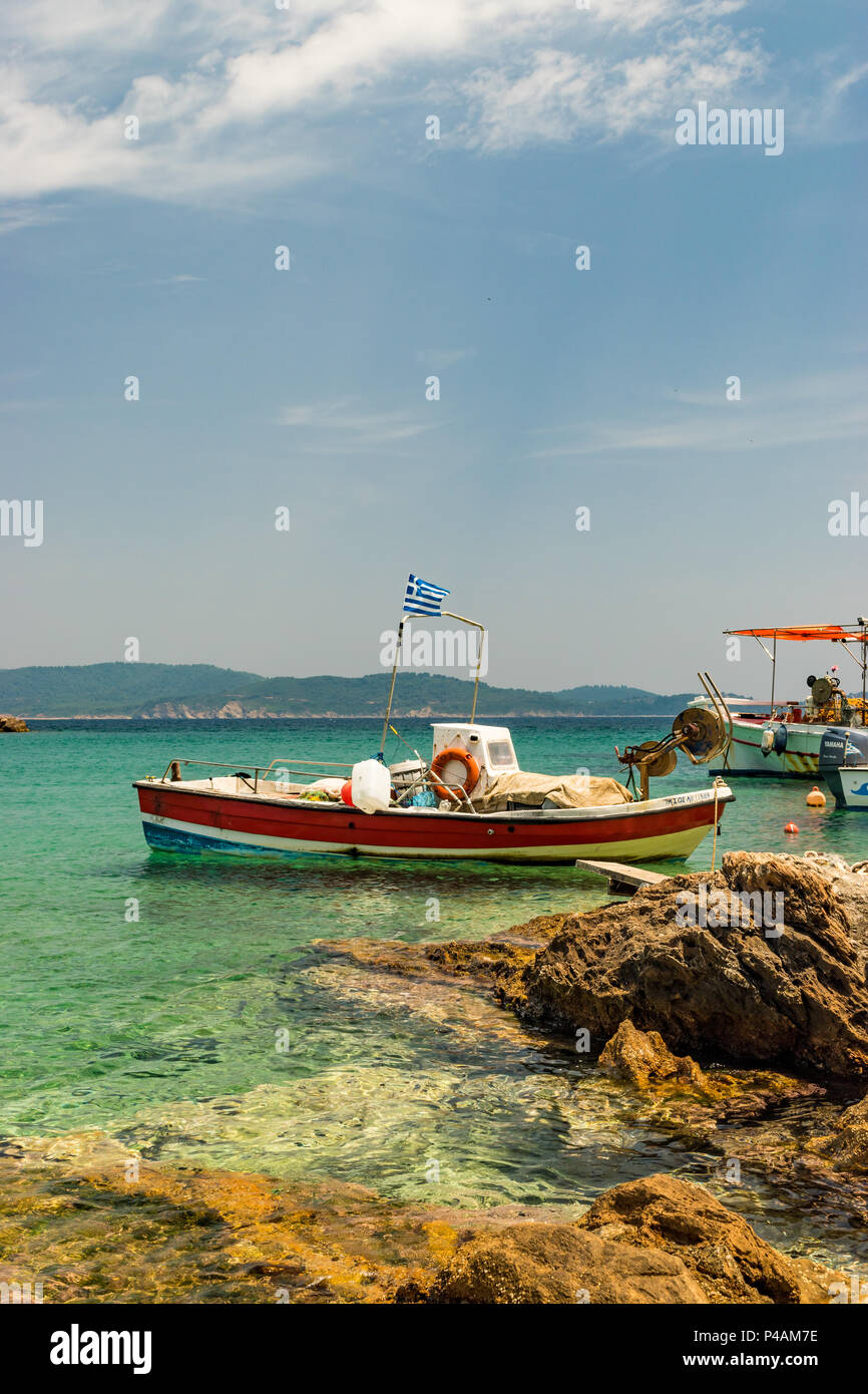 Traditional fishing boat moored up on the Greek mainland. - Stock Image