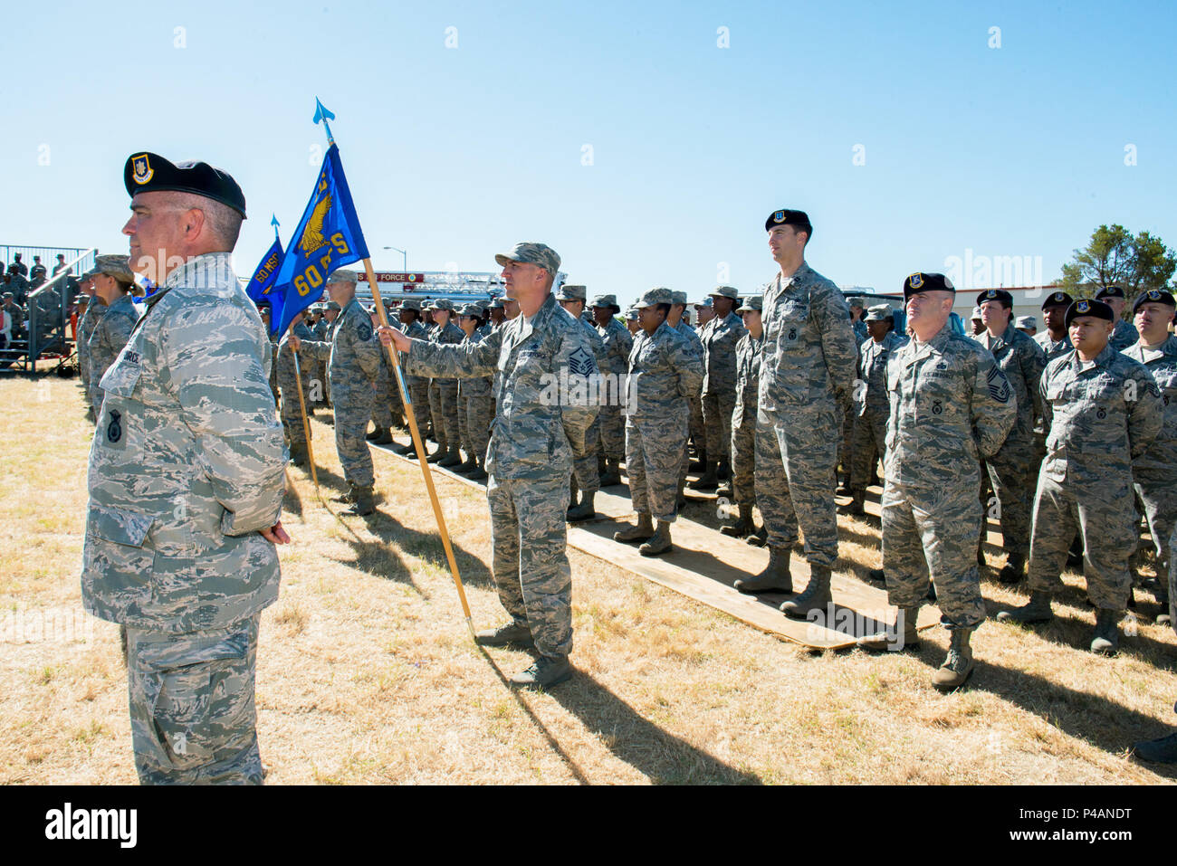 Members of the 60th Mission Support Group, Travis Air Force Base, Calif., stand in formation during Change of Command Ceremony.  U.S. Air Force Col. George Dietrich relinquished command to U.S. Air Force Col. Lance Clark, June 24, 2016. (U.S. Air Force photo by Louis Briscese/Released) - Stock Image