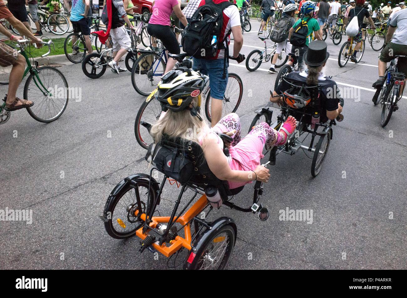 Tandem recumbent bicyclists in the Tour de Fat parade winding its way through downtown Minneapolis. Minneapolis Minnesota MN USA - Stock Image