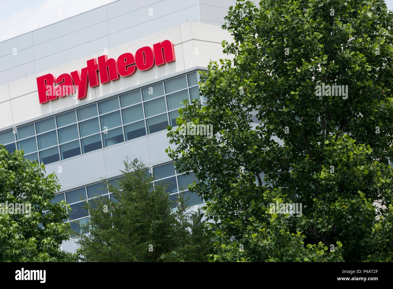 A logo sign outside of a facility occupied by The Raytheon Company in Dulles, Virginia on June 9, 2018. - Stock Image
