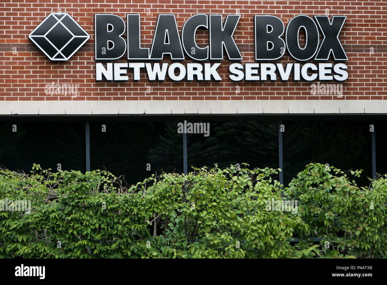 A logo sign outside of a facility occupied by Black Box Network Services in Herndon, Virginia on June 9, 2018. - Stock Image
