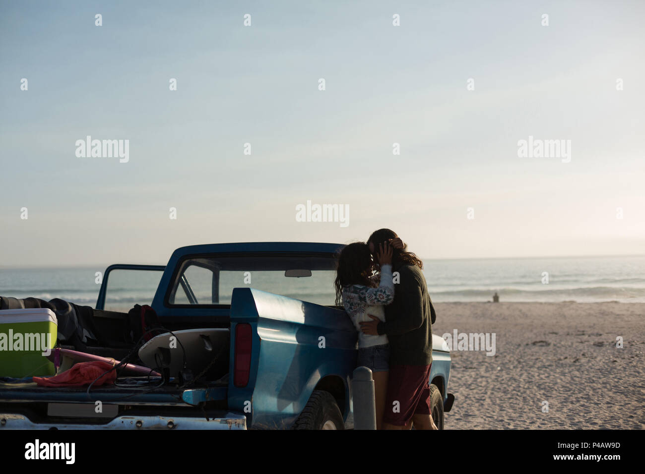 Couple kissing each other in the beach Stock Photo