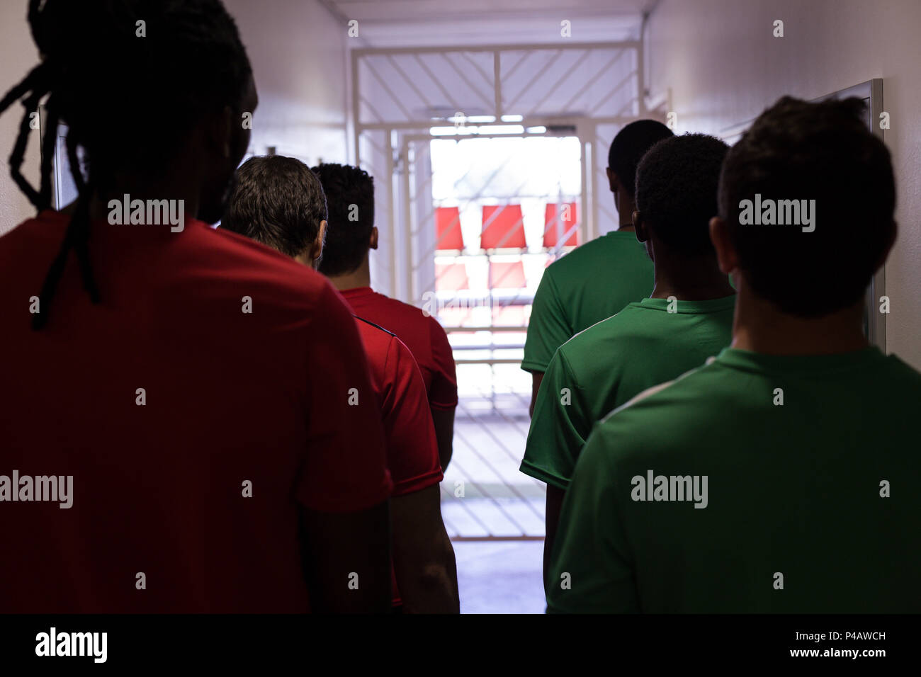 Football players leaving the dressing room - Stock Image