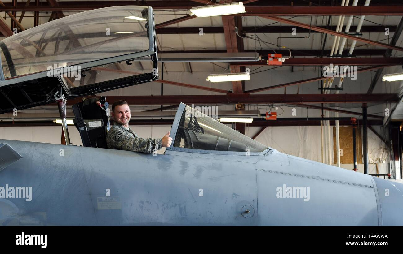Staff Sgt. Matthew Carraway, 362nd Training Squadron F-15 crew chief apprentice course instructor, poses for a picture while in the cockpit of a F-15 Eagle trainer jet at Sheppard Air Force Base, Texas, June 5, 2018, June 5, 2018. Carraway recently graduated his own class, who he dubbed the 'most photogenic class' of the 362nd TRS. (U.S. Ari Force photo by Airman 1st Class Pedro Tenorio). () - Stock Image