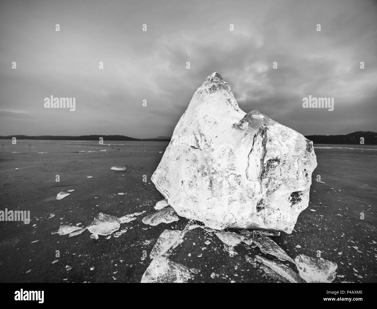 Blocks of shining ice and snow on the shore. The floes and crushed ice  during the evening and dark  hours when the ice at sea breaks up. - Stock Image