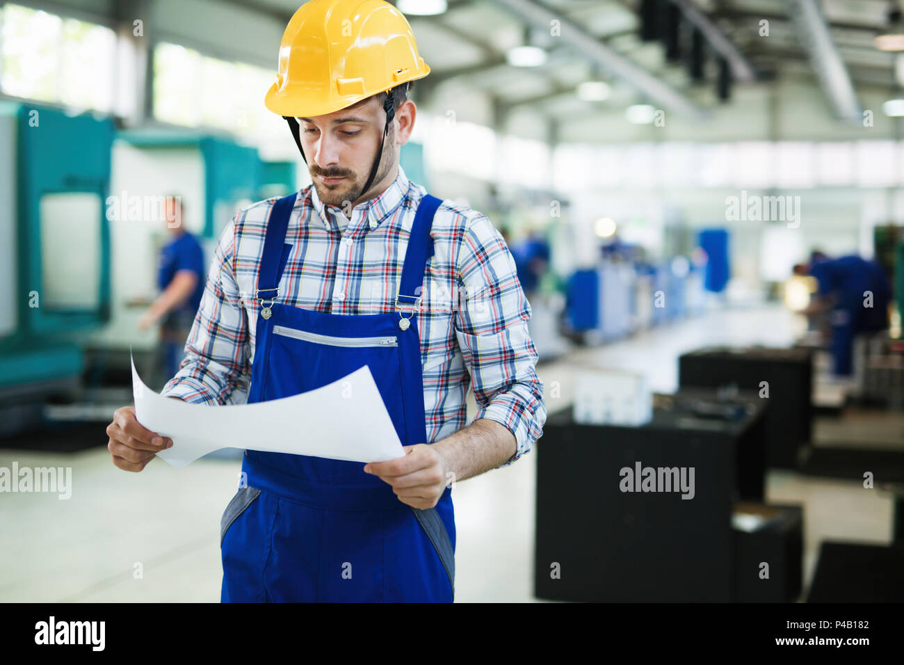 industrial factory employee working in metal manufacturing industry Stock Photo