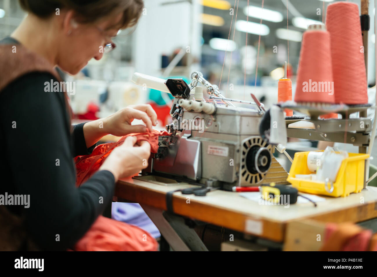 Woman working in textile industry - Stock Image