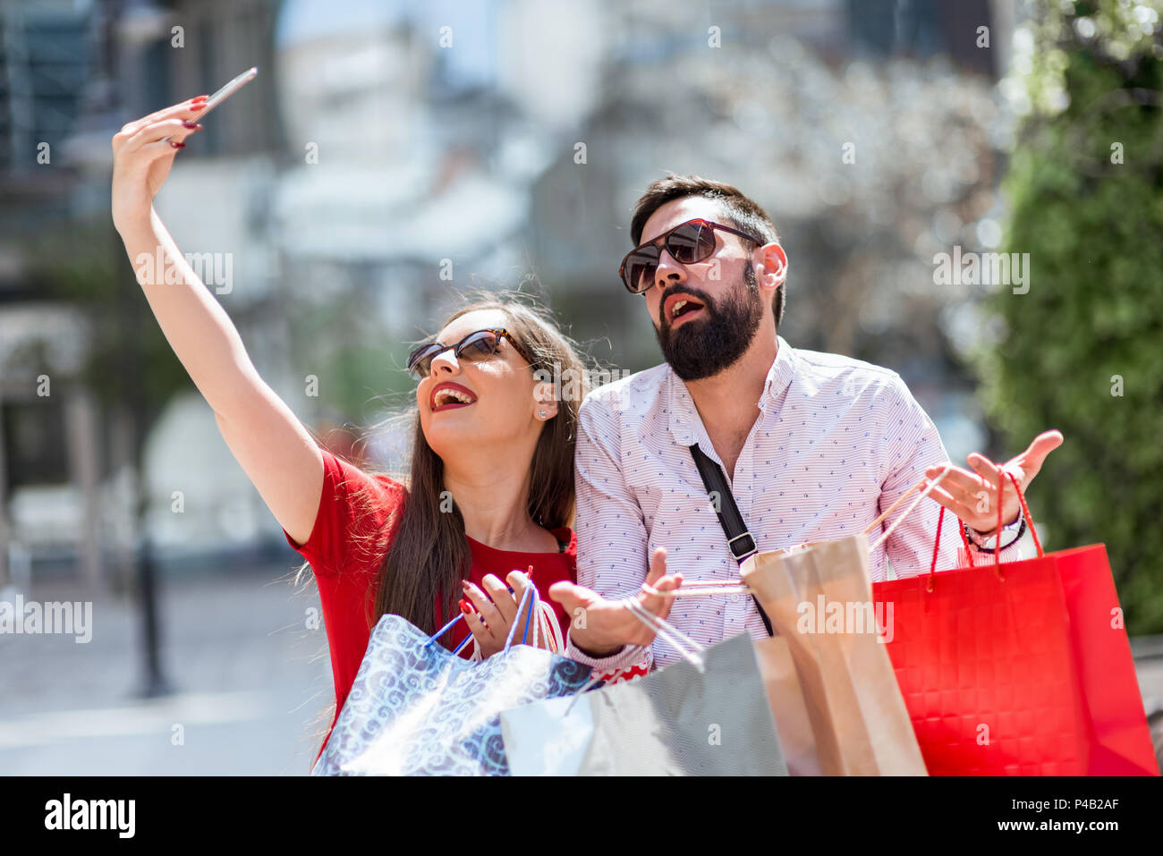 Shoping in the city.Loverly couple having fun on the Macedonian streets. - Stock Image