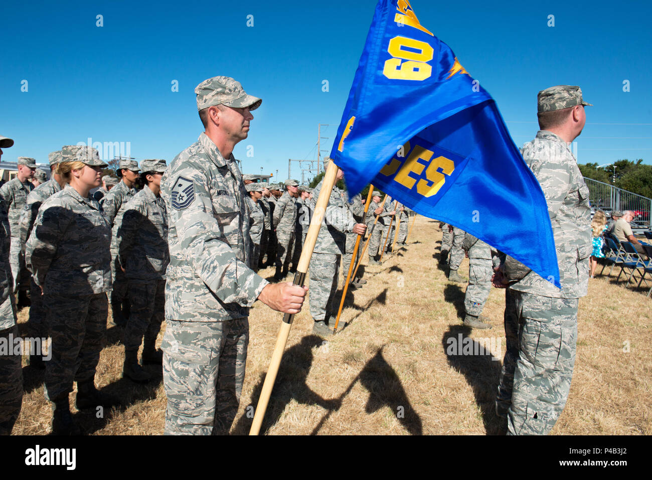Members of the 60th Mission Support Group, Travis Air Force Base, Calif., stand in formation during the Change of Command Ceremony.  U.S. Air Force Col. George Dietrich relinquished command to U.S. Air Force Col. Lance Clark, June 24, 2016. (U.S. Air Force photo by Louis Briscese/Released) - Stock Image