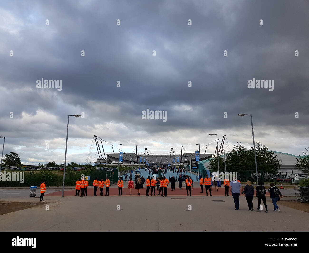 Manchester, England, UK, June 19, 2018: Guests arriving for the Foo Fighters Concert in the Etihad Stadium, crossing through security. - Stock Image