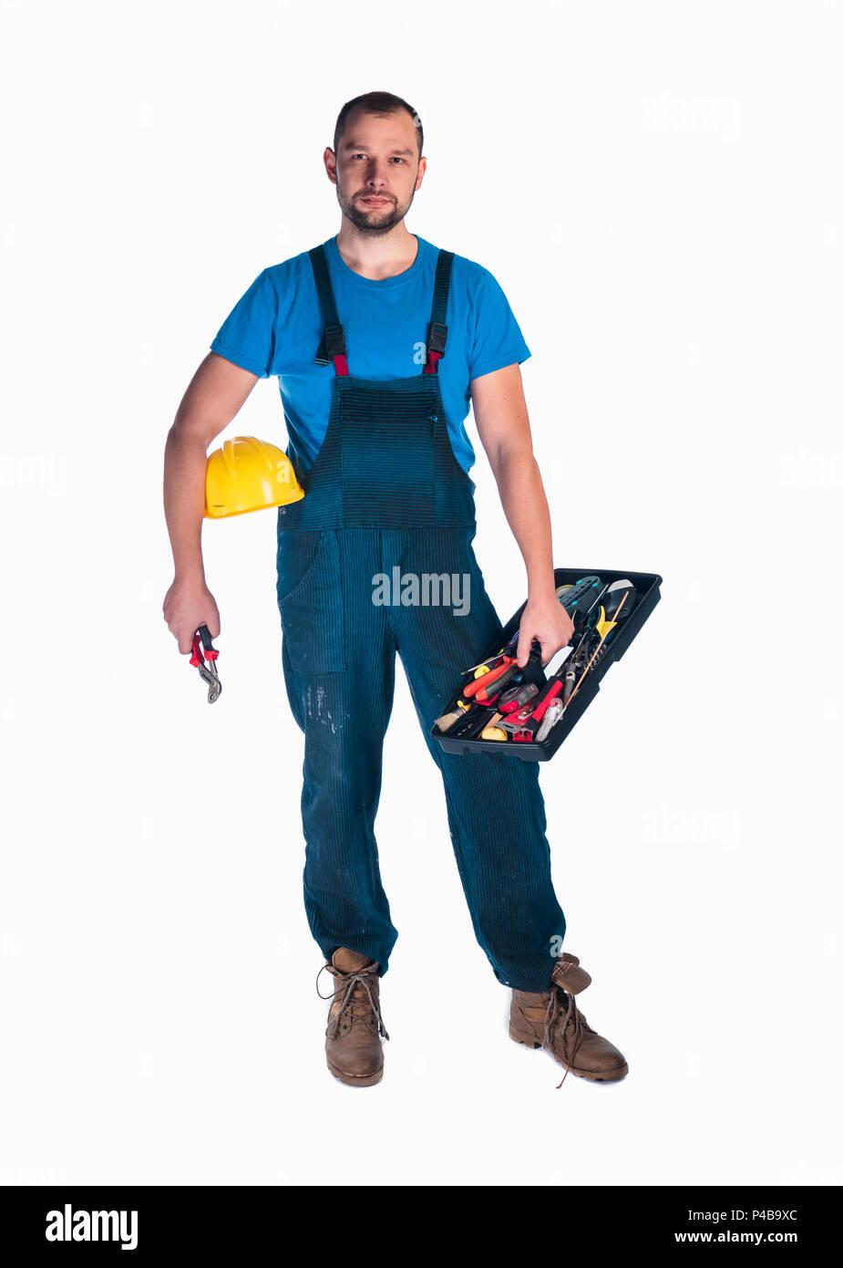Handyman standing isolated on white in studio - Stock Image