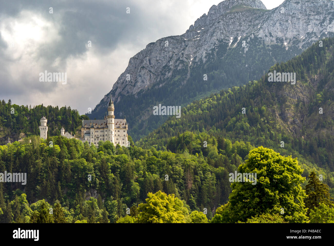 Neuschwanstein Castle is a 19th-century Romanesque Revival palace on a hill above the village of Hohenschwangau near Füssen in southwest Bavaria. Stock Photo