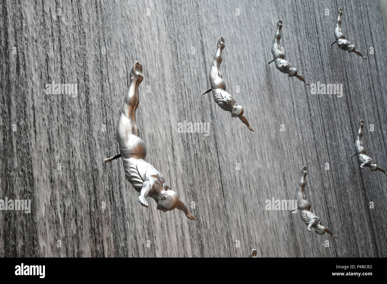 Flying man waterfall at Dubai mole, United Arab Emirates, Emirati, Middle East, Middle Eastern - Stock Image